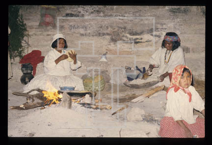 3.b.2-09.71 cave dwelling interior with family preparing corn tortillas over a fire- near village of Basiwari
